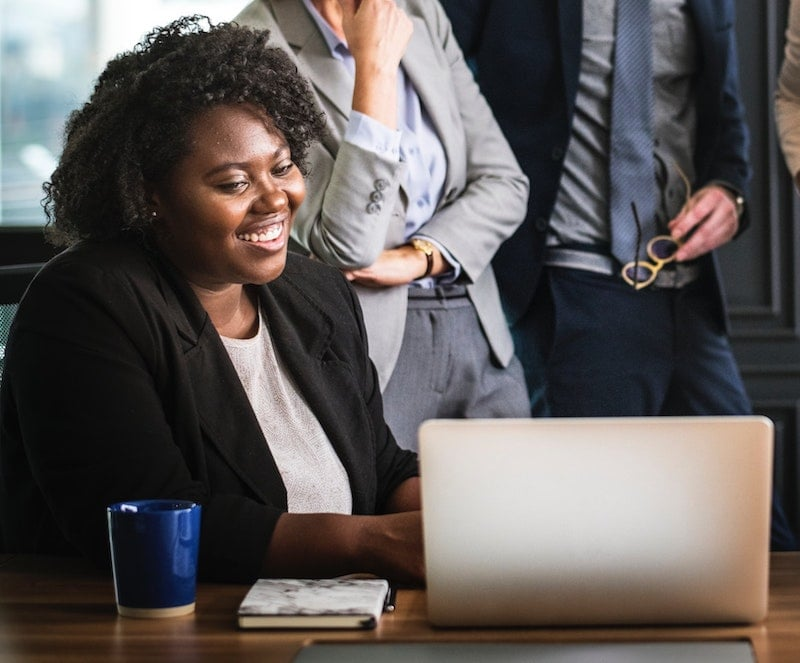Woman at desk during onboarding process