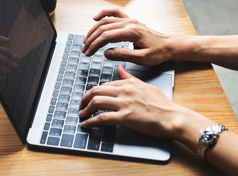 hands typing job offer letter